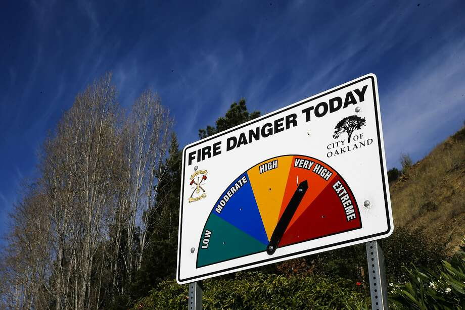 A fire warning sign along Hiller Dr. on Wednesday October 19, 2016, in Oakland, California, is seen twenty-five years after the Oakland hills fire. Photo: Michael Macor, The Chronicle