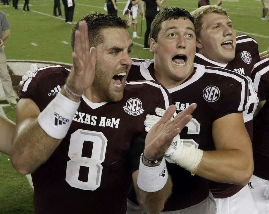 Texas A&M's Trevor Knight (8) and Tanner Schorp (center), both former Reagan High School standouts, celebrate after beating Tennessee on Oct. 8, 2016, in College Station. Photo: David J. Phillip /Associated Press / AP