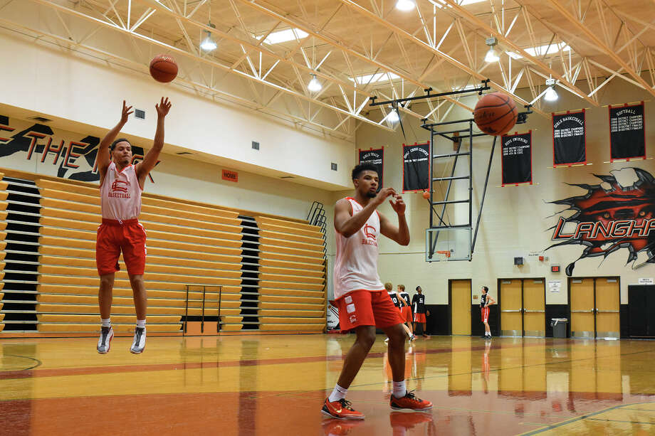 Langham Creek senior shooting guard Ellis Jones (left) and senior forward Ross Thompson (right) take jumpers during shooting drills at basketball practice. Jones and Thompson both project to be key cogs in head coach Charles Ament's scheme, and both will be much-improved this season, per Ament. Photo: Tony Gaines / HCN, Photo