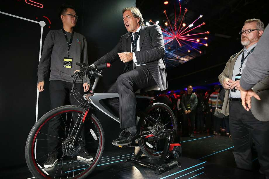 Earth Marketing LLC founder and CEO Tom Keefer, of Los Angeles, tries out the super bike of LeEco at the Chinese company's product announcement in San Francisco in 2016. Photo: Liz Hafalia / The Chronicle