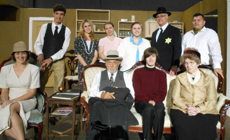 "Baytown Little Theatre will present ""The Diary of Anne Frank"" at its new home, 2 E. Texas Ave., Baytown, Oct. 21-23 and Oct. 28-30. The cast includes, from left, first row: Miranda Heck, Thomas Grail, Matthew Pruett and Katie Reed; back row:  Xavier Lehew, Taylor Pruett, Amber Hutton, Brianna Butler, Kevin Pruett and Rick Olsen. Photo: Julia Jay"