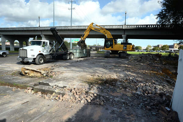 A demolition crew removes rubble Wednesday from the former Gallagher's steak house located next to the Maury Meyers Bridge by Interstate 10 at Laurel Avenue.  Photo taken Tuesday, October 19, 2016 Guiseppe Barranco/The Enterprise