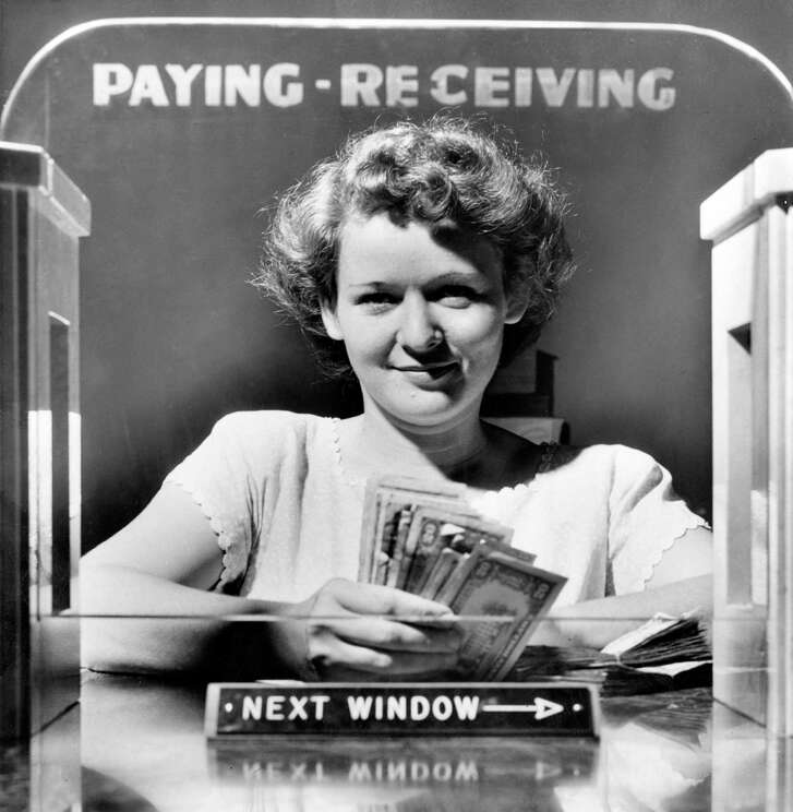 """June 25, 1949: Lona Edwards, Houston bank clerk.    Things were pretty slow on Saturday, June 25, 1949, at North Main State Bank. Well, at least until the bank got robbed late in the morning.      Lona Edwards had come back to her window after getting a Coke when a well-dressed man told her to open her cash drawer and give her $50 and $100 bills. To drive home his point that this was a heist, he raised his right coat pocket with his hand inside to give off the impression that he was armed.     The Houston Post said the next day that it was all done so smoothly that the teller in the next cage didn't know what was going on.     The man fled over to Freeman Street, down to James Street and came across James Slay, manager of Squeeky's Garage at 609 James.     The robber paused and said """"How do you do?"""" to Slay before running off to a brown Oldsmobile and """"driving off rapidly, waving jauntily at Slay as he did so."""""""