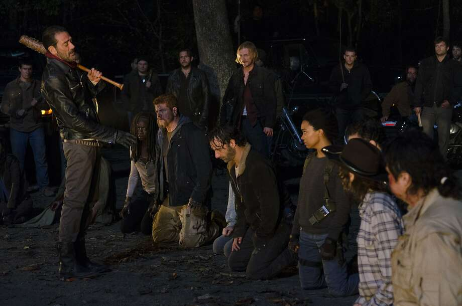 "Negan (Jeffrey Dean Morgan) stands before Michonne (Danai Gurira), Abraham (Michael Cudlitz), Maggie (Lauren Cohan), Rick (Andrew Lincoln) and Sasha (Sonequa Martin-Green), Carl (Chandler Riggs) and Eugene (Josh McDermitt) during the final cliffhanger scene of season six of AMC's ""The Walking Dead."" Click through the slideshow to read 11 theories on who Negan killed. Photo: Gene Page/AMC, TNS"