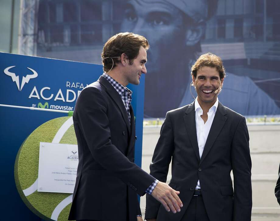 Spanish tennis player Rafael Nadal (R) laughs beside Swiss's player tennis Roger Federer during the opening of the Rafa Nadal Academy in Manacor on October 19, 2016. / AFP PHOTO / JAIME REINAJAIME REINA/AFP/Getty Images Photo: JAIME REINA, AFP/Getty Images
