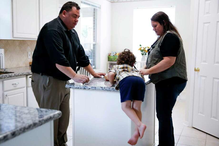 Drake Pawloski, 3, distracts his parents from politics. Photo: Michael Ciaglo, Staff / © 2016  Houston Chronicle