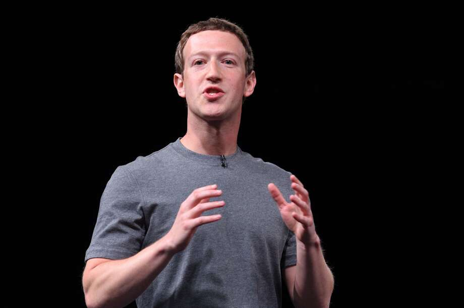 Chairman, chief executive, and co-founder of the social networking website Facebook Mark Zuckerberg speaks during a press conference presenting Samsung's new Galaxy 7 mobile device, on the eve of the official opening of the Mobile World Congress in Barcelona on February 21, 2016. The world's biggest mobile fair, Mobile World Congress, is held from February 22 to February 25.