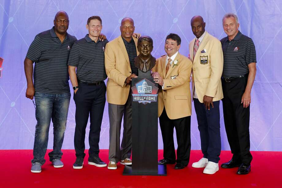 Pro Football Hall of Fame class of 2016 inductee former owner of the San Francisco 49ers Edward J. Bartolo Jr, third from right, is joined by a group of 49er Pro Football Hall of Famers from left; Charles Haley, Steve Young, Ronnie Lott, Jerry Rice and Joe Montana during an induction ceremony at the Pro Football Hall of Fame Saturday, Aug. 6, 2016, in Canton, Ohio. (AP Photo/Gene J. Puskar) Photo: Gene J. Puskar, Associated Press