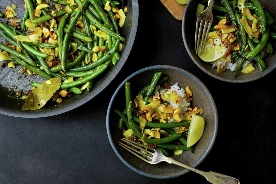 Green beans with mustard seeds, cashews and coconut, in New York, Aug. 18, 2016. This richly spiced recipe has enough protein from the cashews to serve over rice as a main course, but is also terrific as a side.  (Andrew Scrivani/The New York Times) ORG XMIT: XNYT21 Photo: ANDREW SCRIVANI / NYTNS