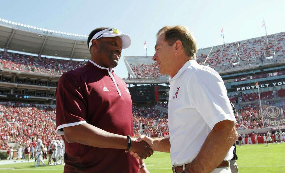 FILE - In this Oct, 18, 2014, file photo, Texas A&M head coach Kevin Sumlin, left, and Alabama head coach Nick Saban shake hands before an NCAA college football game in Tuscaloosa, Ala. The SEC West could be all but decided this Saturday. The leader will be determined in Tuscaloosa, Alabama, when the top-ranked Crimson Tide (7-0) faces No. 6 Texas A&M (6-0).  The winner is the only undefeated team left in the Southeastern Conference and loser will need the winner to lose twice to have a chance to win the West. (AP Photo/Butch Dill, File) Photo: Brynn Anderson, FRE / Copyright 2016 The Associated Press. All rights reserved.
