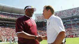 FILE - In this Oct, 18, 2014, file photo, Texas A&M head coach Kevin Sumlin, left, and Alabama head coach Nick Saban shake hands before an NCAA college football game in Tuscaloosa, Ala. The SEC West could be all but decided this Saturday. The leader will be determined in Tuscaloosa, Alabama, when the top-ranked Crimson Tide (7-0) faces No. 6 Texas A&M (6-0).  The winner is the only undefeated team left in the Southeastern Conference and loser will need the winner to lose twice to have a chance to win the West. (AP Photo/Butch Dill, File)