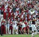 Alabama fans react as Crimson Tide defensive back Minkah Fitzpatrick (29) runs in an interception for a touchdown in the fourth quarter against Texas A&M on Oct. 17, 2015, in College Station.