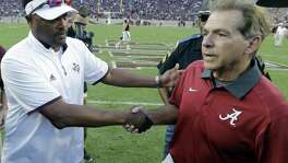 Alabama coach Nick Saban (right) shakes hands with Texas A&M head coach Kevin Sumlin following the Crimson Tide's 41-23 win over the Aggies on Oct. 17, 2015, in College Station,