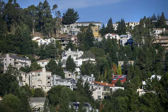 Homes along Charing Cross Road in Oakland, California., as seen on Wednesday October 19, 2016, twenty-five years after the Oakland hills fire.