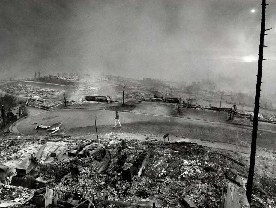 In a view toward the bay from the Oakland hills, the devastation on Kent Road after the 1991 fire looks otherworldly. Photo: Frederic Larson, The Chronicle