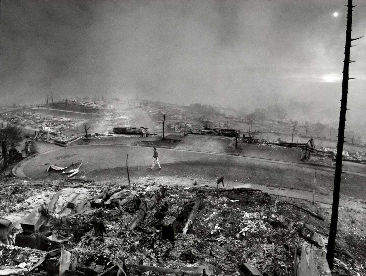Devastation on Kent Road after the Oakland hills fire of October 1991; view is toward the bay from the Oakland hills.