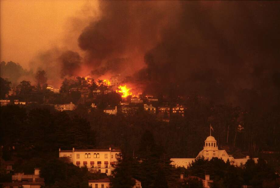 Oakland Hills Fire burned hundreds of homes, on Oct. 20, 1991.  Aerial fire bombers were used to extingues flames during the firestorm.  The Clairmont Hotel, foreground, was not damaged. Photo: Brant Ward, The Chronicle