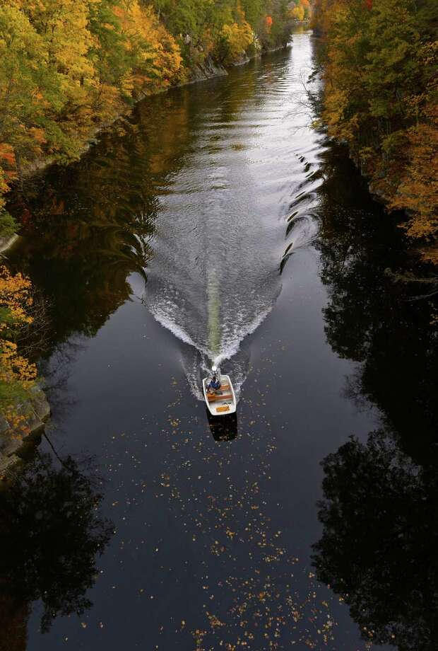 A small power boat makes it's  way up the Housatonic River, at Lovers Leap, in New Milford, Conn, on Tuesday, October 27, 2015. Photo: H John Voorhees III / Hearst Connecticut Media / The News-Times