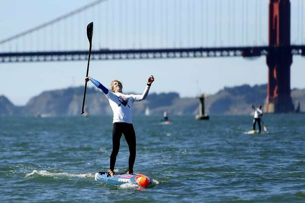 Conor Baxter celebrates finishing first in Red Bull Heavy Water race in San Francisco, Calif., on Wednesday, October 19, 2016.