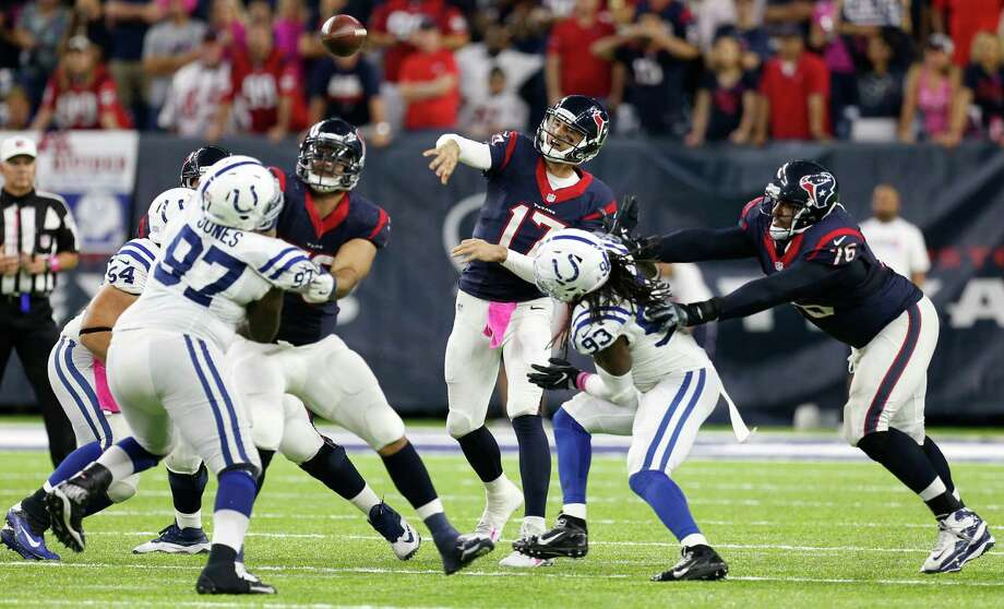 Houston Texans quarterback Brock Osweiler (17) throws a pass over the Indianapolis Colts defense to Texans tight end C.J. Fiedorowicz in overtime of an NFL football game at NRG Stadium on Sunday, Oct. 16, 2016, in Houston. ( Brett Coomer / Houston Chronicle ) Photo: Brett Coomer, Staff / © 2016 Houston Chronicle