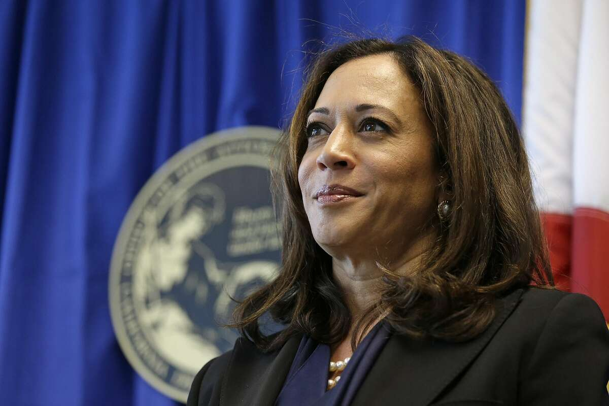 California Attorney General Kamala Harris listens to questions about a settlement with Volkswagen during a news conference Tuesday, June 28, 2016, in San Francisco. Volkswagen will spend up to $15.3 billion to settle consumer lawsuits and government allegations that it cheated on emissions tests in what lawyers are calling the largest auto-related class-action settlement in U.S. history. Up to $10 billion will go to 475,000 VW or Audi diesel owners, who thought they were buying high-performance, environmentally friendly cars but later learned the vehicles' emissions vastly exceeded U.S. pollution laws. (AP Photo/Eric Risberg)