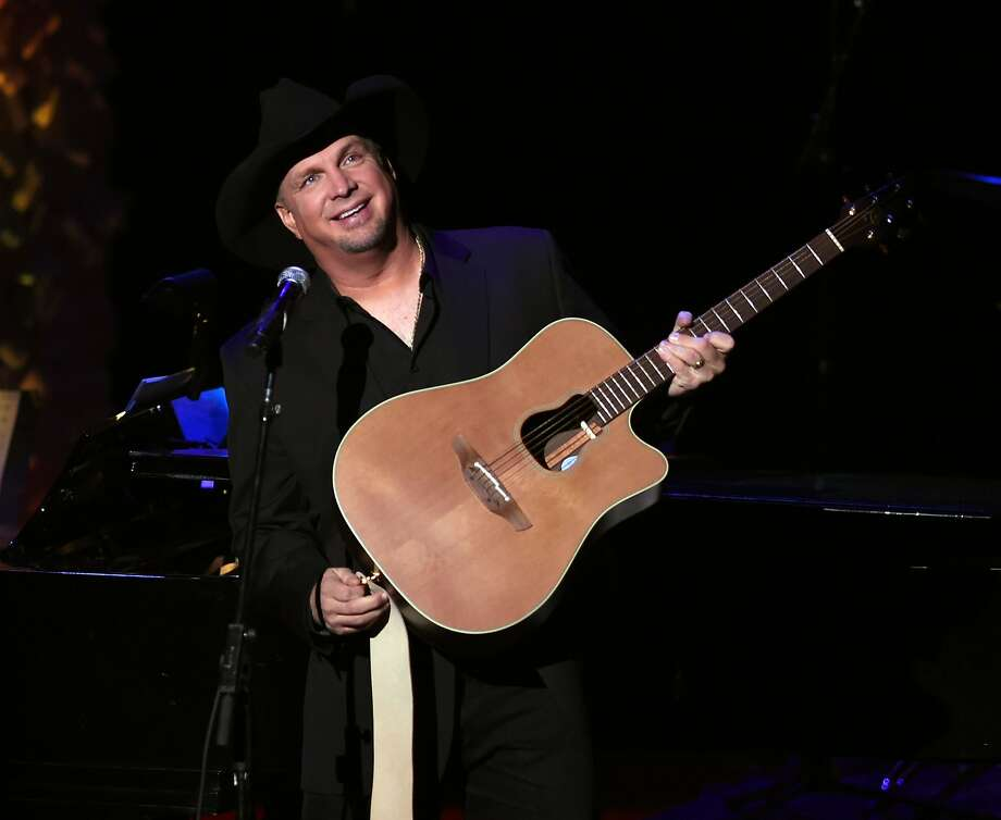 (FILES) This file photo taken on November 17, 2014 shows Centennial Award Recipient  Garth Brooks  during the American Society of Composers, Authors and Publishers ASCAP Centennial Awards ceremony in New York. Amazon's new streaming service on October 19, 2016 announced an exclusive deal with country superstar Garth Brooks, the top-selling artist to have resisted the fast-growing music format. The retail giant, which launched its Amazon Music Unlimited service last month with a cut-rate price for owners of the company's speakers, started with a new single by Brooks and will eventually stream his entire catalog.  / AFP PHOTO / TIMOTHY A. CLARYTIMOTHY A. CLARY/AFP/Getty Images Photo: TIMOTHY A. CLARY, AFP/Getty Images