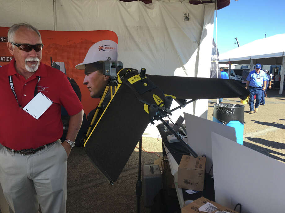 A drone purpose built for surveying is on display at West Co.'s booth Wednesday, Oct. 19, 2016, at the Permian Basin International Oil Show. The drone is fitted with the latest surveying technology and can survey land parcels much faster and in more detail than traditional manned crews. Trevor Hawes/Reporter-Telegram Photo: Trevor Hawes/Midland Reporter-Telegram