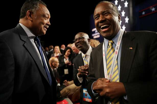 Former presidential candidate, Dr. Ben Carson speaks with Jesse Jackson before the start of the third U.S. presidential debate at the Thomas & Mack Center on October 19, 2016 in Las Vegas, Nevada. Tonight is the final debate ahead of Election Day on November 8.