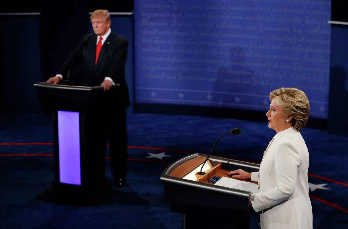 Democratic presidential nominee Hillary Clinton speaks as Republican presidential nominee Donald Trump listens during the third presidential debate at UNLV in Las Vegas, Wednesday, Oct. 19, 2016. (Mark Ralston/Pool via AP)