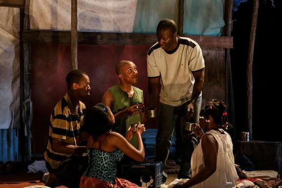 "Joseph (Reggie D. White, left), Laurie (Jasmine St. Clair), Emmanuel (Clinton Roane), Max (Andy Lucien) and Rose (Brittany Bellizeare) in ""The Last Tiger in Haiti"" at Berkeley Rep."