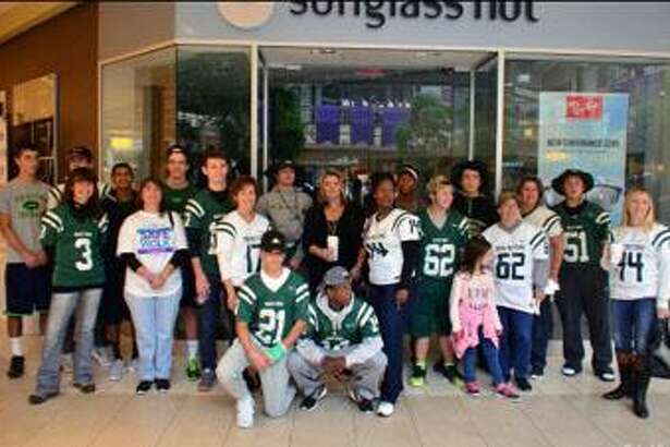 The New Milford High School football team, along with players mothers, recently participated in the Women's Center of Greater Danbury'ss annual Safe Walk held at Danbury Fair Mall. The walk helps to raise domestic violence awareness and funds for many programs. The women's center's services include 24 hour hotlines, emergency shelter, individual counseling and support groups to those in need.