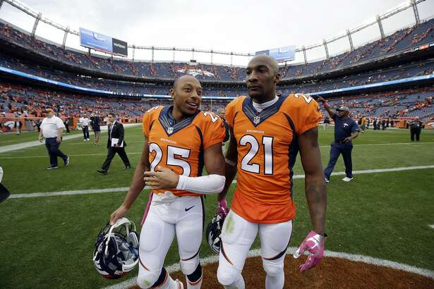 Denver Broncos cornerback Chris Harris (25) and Aqib Talib (21) walk off the field after a loss to the Atlanta Falcons a football game, Sunday, Oct. 9, 2016, in Denver. The Falcons won 23-16. (AP Photo/Jack Dempsey)