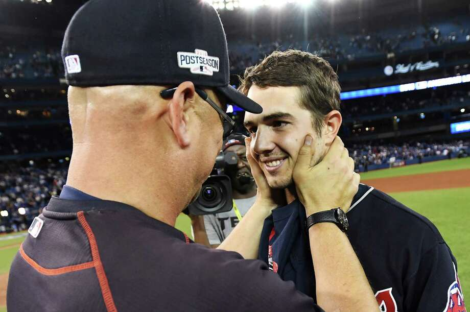 Cleveland Indians manager Terry Francona, left, congratulate starting pitcher Ryan Merritt after the Indians defeated the Toronto Blue Jays 3-0 during Game 5 of the baseball American League Championship Series, in Toronto on Wednesday, Oct. 19, 2016. (Frank Gunn/The Canadian Press via AP) ORG XMIT: FNG525 Photo: Frank Gunn / The Canadian Press