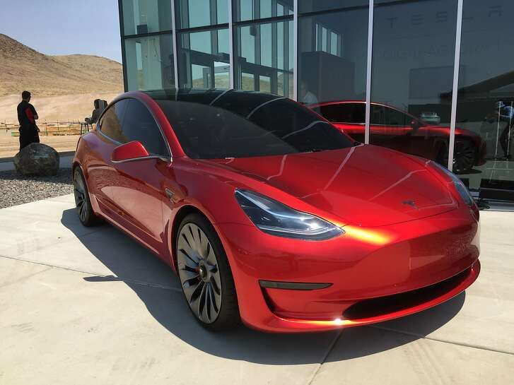 A prototype of the $35,000 Tesla Motors Model 3, outside the company's Gigafactory in Nevada.