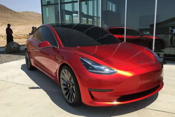 A prototype of the $35,000 Tesla Motors Model 3, outside the company's Gigafactory in Nevada.
