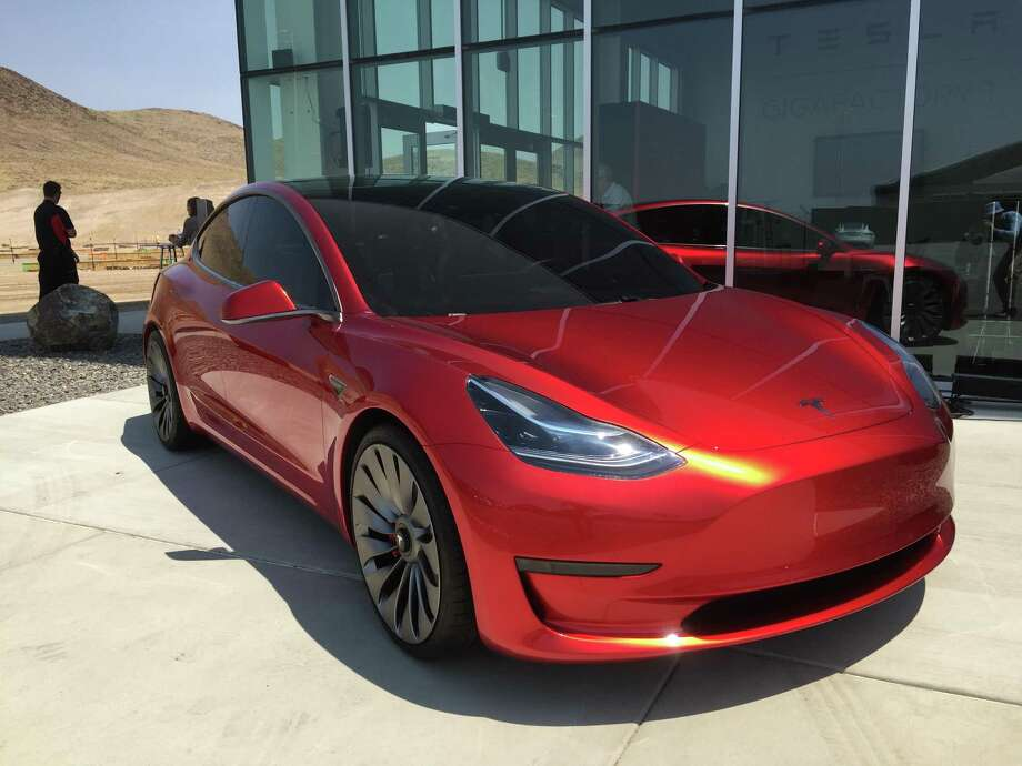 Tesla Motors announced Wednesday that starting immediately, all of its cars — including the upcoming Model 3, shown here — will include the hardware needed to drive themselves. Photo: Photo By David R. Baker, The Chronicle / /