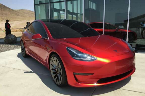 Tesla Motors announced Wednesday that starting immediately, all of its cars — including the upcoming Model 3, shown here — will include the hardware needed to drive themselves.