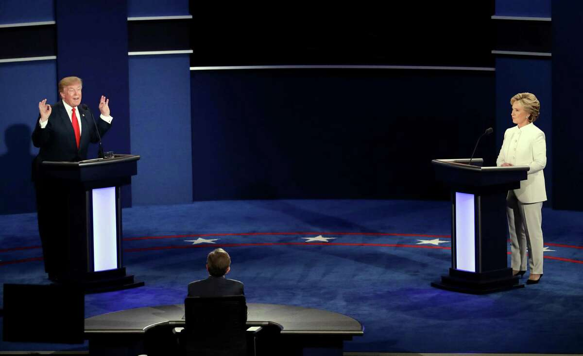 Republican presidential nominee Donald Trump debates Democratic presidential nominee Hillary Clinton during the third presidential debate at UNLV in Las Vegas, Wednesday, Oct. 19, 2016.