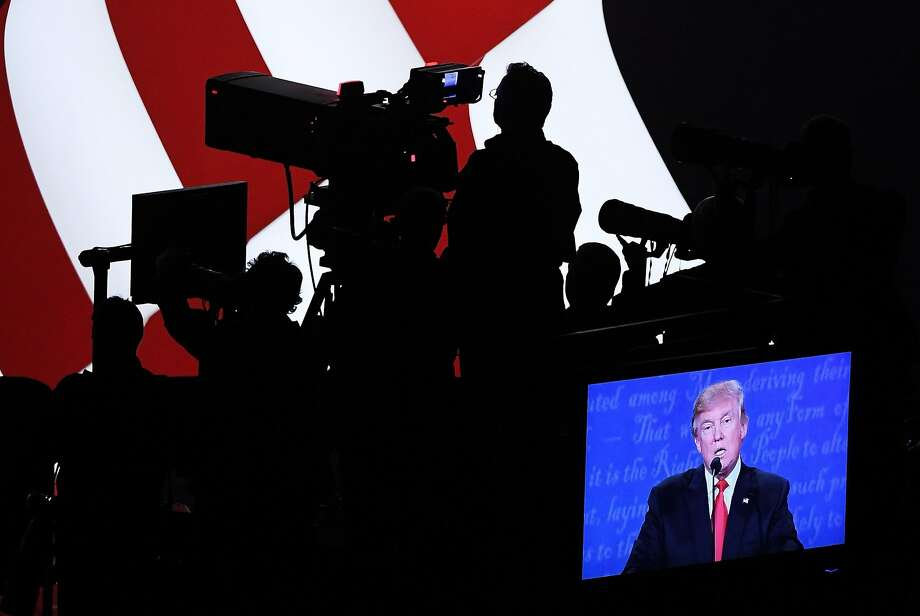 Donald Trump is projected on a screen as he speaks during the third U.S. presidential debate in LasVegas on Wednesday. Photo: Ethan Miller, Getty Images