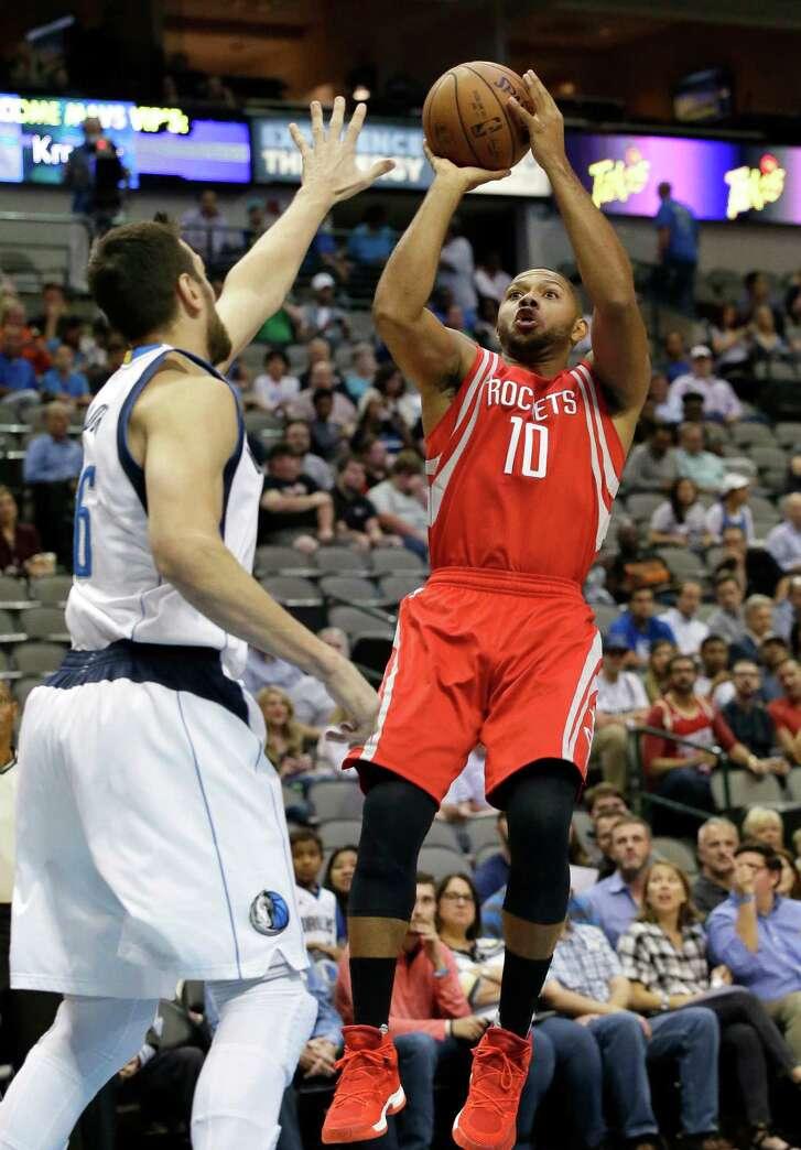Houston Rockets guard Eric Gordon (10) shoots against Dallas Mavericks center Andrew Bogut (6) during the first half of an NBA preseason basketball game Wednesday, Oct. 19, 2016, in Dallas. (AP Photo/LM Otero)