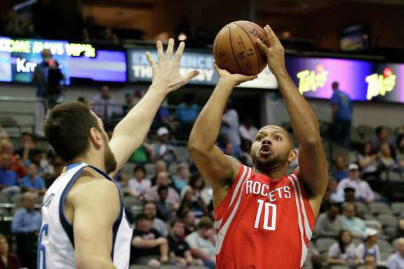 Houston Rockets guard Eric Gordon (10) shoots against Dallas Mavericks center Andrew Bogut (6) during the first half of an NBA preseason basketball game Wednesday, Oct. 19, 2016, in Dallas. (AP Photo/LM Otero)