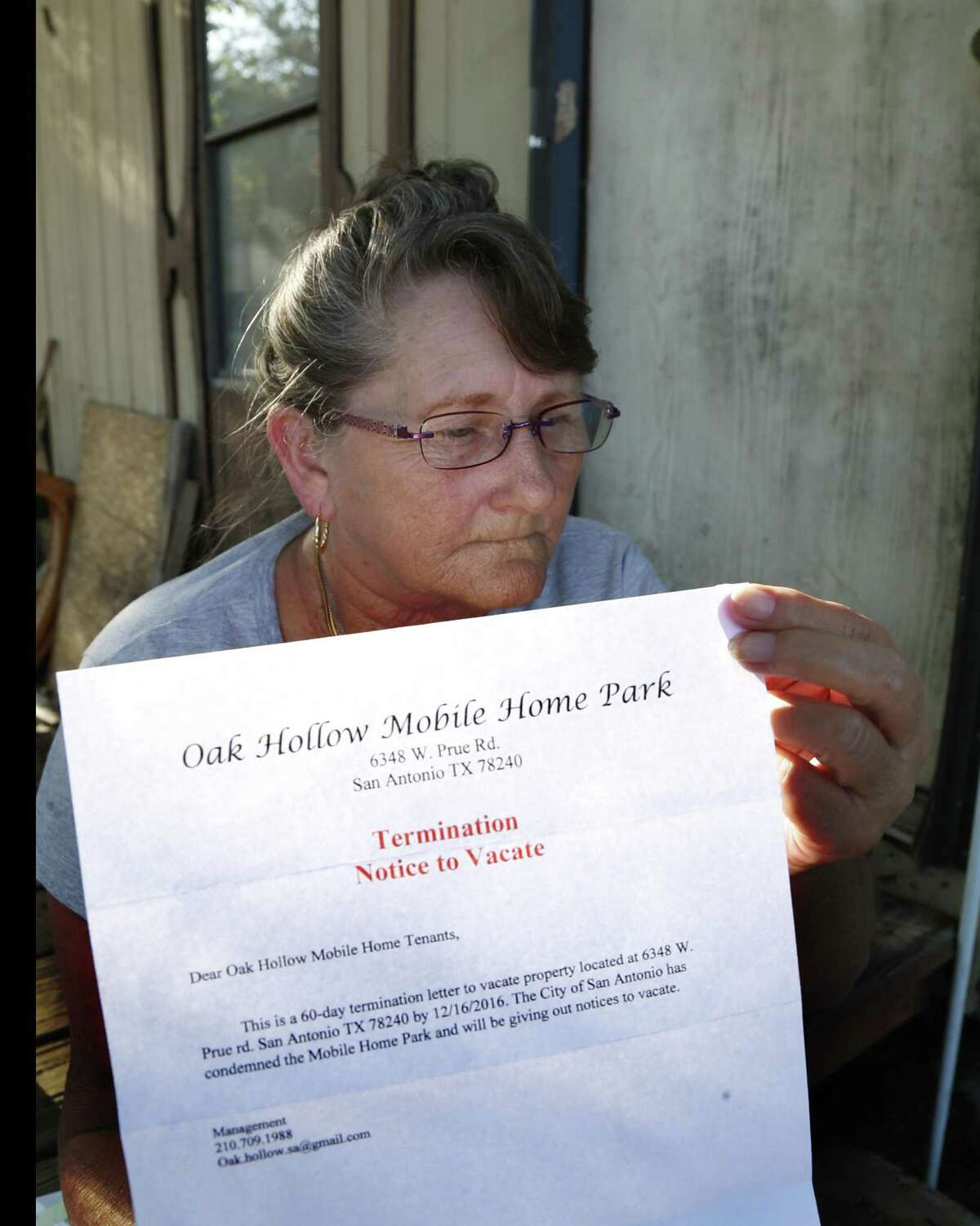 Sharon Dumph shows the certified letter she and other residents received concerning the situation at the Oak Hollow Mobile Home Park at 6348 Prue Road on Oct. 19, 2016.