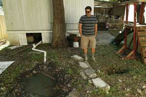 Jesus Arredondo stands in front of a trailer at the Oak Hollow Mobile Home in October, where 12 septic tanks overflowed and spilled sewage. The city has filed a lawsuit against the property owners.