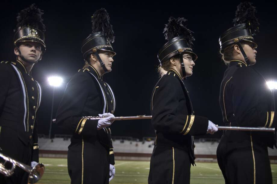 Bullock Creek High School marching band members from left: Nick Jozwiak, Morgan Fodo, Trina Hill and Ella Lindgren wait to perform at Midland Stadium during the 2016 Midland Marching Band Showcase Wednesday evening. A total of 10 local high school marching bands performed sets for 15 minutes. Photo: Brittney Lohmiller/Midland Daily News/Brittney Lohmiller