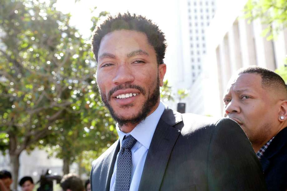 NBA star Derrick Rose smiles as he leaves federal court in Los Angeles Wednesday, Oct. 19, 2016. Jurors cleared Rose and two friends in a lawsuit that accused them of gang raping his ex-girlfriend when she was incapacitated from drugs or alcohol. The jury reached the verdict Wednesday in Los Angeles federal court after hearing dramatically different accounts of the August 2013 sexual encounter. (AP Photo/Nick Ut) ORG XMIT: LA105 Photo: Nick Ut / Copyright 2016 The Associated Press. All rights reserved. This m