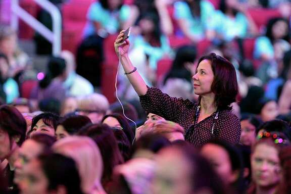 Cintia Barcelos takes a selfie Wednesday during the Grace Hopper Celebration of Women in Computing conference.