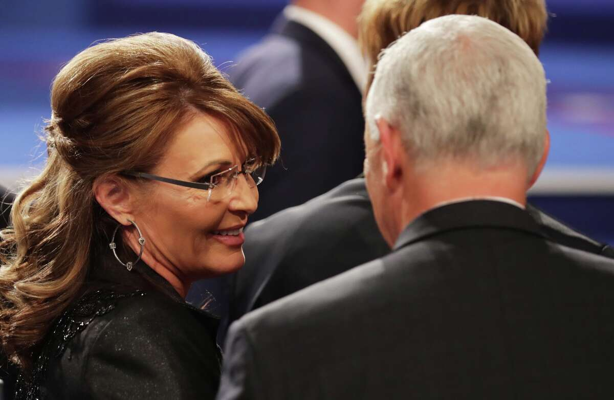Former Gov. Sarah Palin (R-Alaska) speaks with Republican vice presidential nominee Mike Pence after the third U.S. presidential debate at the Thomas & Mack Center in Las Vegas on Oct. 19, 2016.