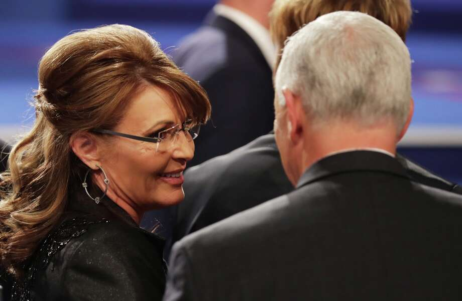 Former Gov. Sarah Palin (R-Alaska) speaks with Republican vice presidential nominee Mike Pence after the third U.S. presidential debate at the Thomas & Mack Center in Las Vegas on Oct. 19, 2016. Photo: Chip Somodevilla/Getty Images