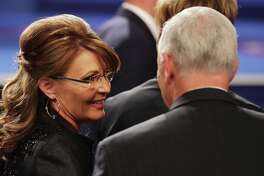 Former Gov. Sarah Palin (R-AK) speaks with Republican vice presidential nominee Mike Pence after the third U.S. presidential debate at the Thomas & Mack Center on October 19, 2016 in Las Vegas, Nevada. Tonight is the final debate ahead of Election Day on November 8.