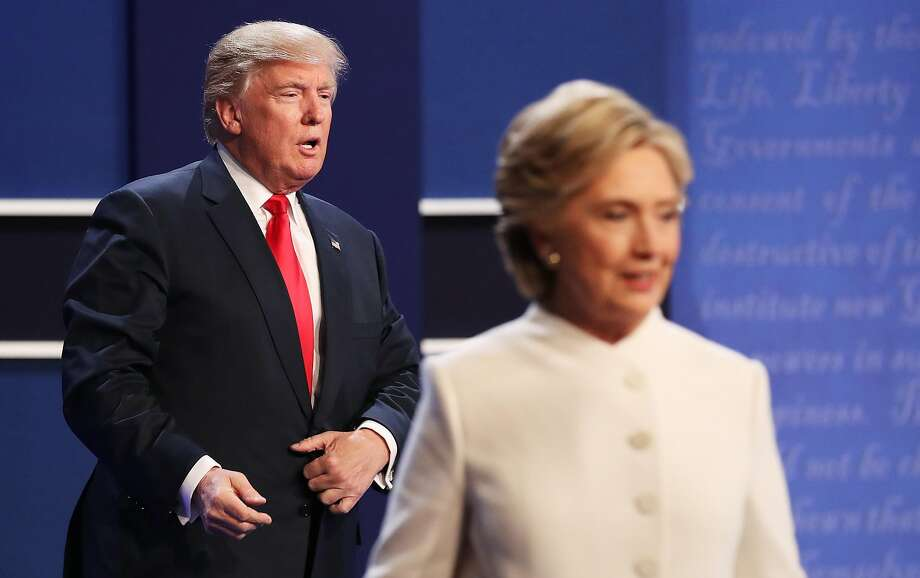 Democratic presidential nominee former Secretary of State Hillary Clinton walks off stage as Republican presidential nominee Donald Trump looks on during the third U.S. presidential debate at the Thomas & Mack Center on October 19, 2016 in Las Vegas, Nevada. Tonight is the final debate ahead of Election Day on November 8. Photo: Drew Angerer, Getty Images